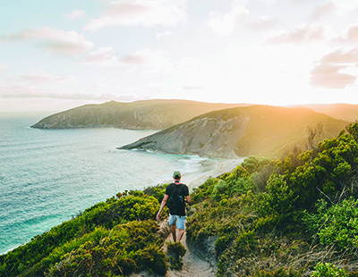 man walking along coast track